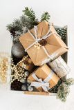 Pile of christmas gift box with decorations on a wooden tray Stock Images