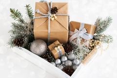 Pile of christmas gift box with decorations on a wooden tray Royalty Free Stock Photos