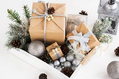 Pile of christmas gift box with decorations on a wooden tray Stock Photo
