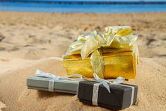 Pile of christmas gifts on beach Royalty Free Stock Image