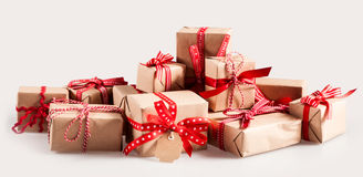Pile of Christmas gifts with colorful bows Royalty Free Stock Image