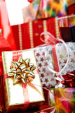 A pile of Christmas gifts in colorful wrapping Stock Photo