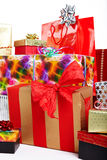 A pile of Christmas gifts in colorful wrapping Stock Photography