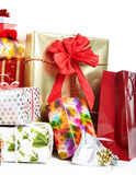 A pile of Christmas gifts in colorful wrapping Stock Photos