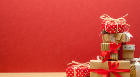 Pile of christmas gifts. Pile of different beautiful christmas gifts on red background Stock Photography