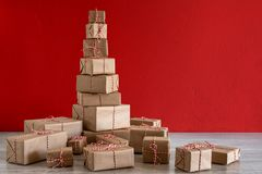 Pile of Christmas gifts wrapped in rustic paper stock photo