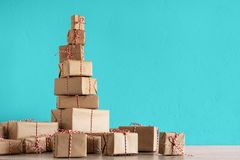 Pile of Christmas gifts wrapped in rustic paper royalty free stock images