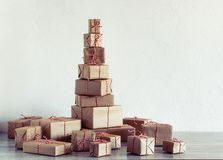 Pile of Christmas gifts wrapped in rustic paper royalty free stock photography