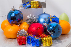 Pile of Christmas toys and fruit Royalty Free Stock Photography