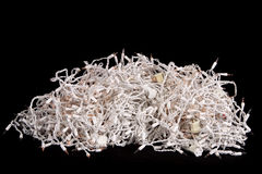 Pile of Christmas tree lights. Big pile of tangled Christmas tree lights isolated on a black background for a dramatic effect Royalty Free Stock Photography