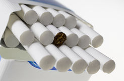 Pile of cigarettes. On the white background Stock Photos