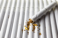 Pile of cigarettes. On the white background Stock Photo