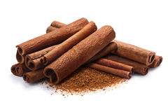 Pile of cinnamon in sticks and ground, paths. Pile of cinnamon sticks with ground cinnamon together. Clipping paths, shadow separated stock photography