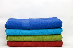 A pile of clean terry towels of different colors Royalty Free Stock Photography