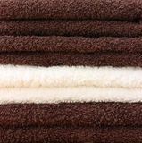 Pile of clean towels. Brown and cream royalty free stock image
