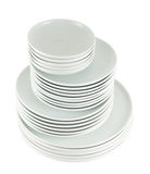 Pile of clean white dish plates isolated Stock Image