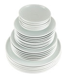 Pile of clean white dish plates isolated Stock Photography