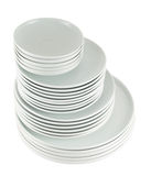Pile of clean white dish plates isolated Stock Photo