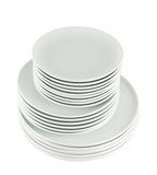 Pile of clean white dish plates isolated Royalty Free Stock Photo