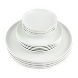 Pile of clean white dish plates isolated Royalty Free Stock Photos
