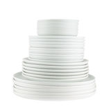 Pile of clean white dish plates isolated Stock Photos