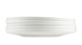 Pile of clean white dish plates isolated Royalty Free Stock Images