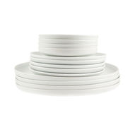 Pile of clean white dish plates isolated Royalty Free Stock Photography