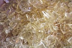 A pile of clear hard candy glass.  Stock Images