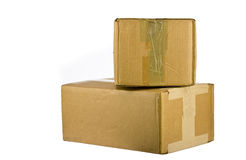 Pile of closed cardboard boxes on white Royalty Free Stock Images