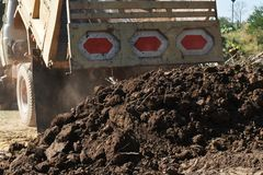 Pile clot soil after pour from truck. Detail pile clot soil after pour from truck Royalty Free Stock Photo