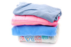 Pile of clothes. A fresh washed and pressed stack of colorful kids clothes. Image isolated on white studio background Royalty Free Stock Photos
