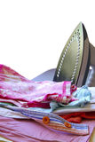 Pile of Clothes. Pile of assorted clothes ready to iron, isolated in white background Stock Photo
