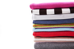Pile of clothes background. Background with folded multicolored clothes and space for the text Royalty Free Stock Images