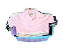 Pile of clothes in basket on white background Stock Photography