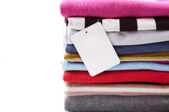 Pile of clothes with blank label Stock Photo