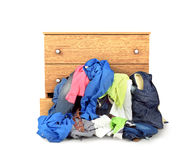 A pile of clothes falling out of the dresser Stock Photography