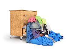 A pile of clothes falling out of the dresser Royalty Free Stock Photos