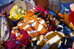Pile of clothes on the flea market Royalty Free Stock Photo