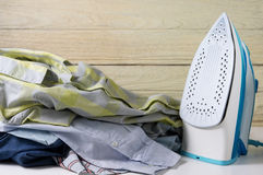 Pile of clothes with iron Stock Images
