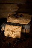 Pile of clothes with pine cones on wooden background Royalty Free Stock Photography