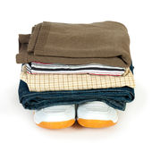 Pile of clothes on the shoes Royalty Free Stock Photo