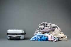 Pile of Clothes and a Suitcase Royalty Free Stock Image