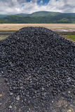 Pile of coal. At Barmouth railway station, Wales Royalty Free Stock Images