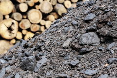 Pile coal and firewood, log fire wood background Stock Photo