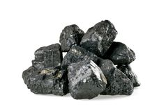 Pile of coal isolated on white. Background stock images