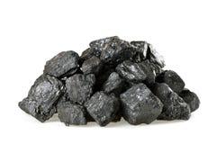 Pile of coal isolated on white stock photos