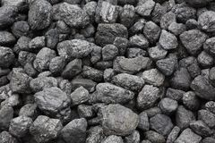 A pile of coal. A large pile of black coal in North Wales where once there was a thriving industry royalty free stock photo