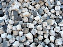 A pile of cobblestones removed from the street stock images