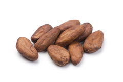 Pile of Cocoa beans. On white. Shallow depth of field stock images