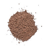 Pile of cocoa powder isolated on the white background Royalty Free Stock Photography